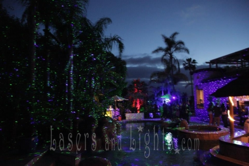 Spright outdoor starfield laser projectors on backyard pool scene