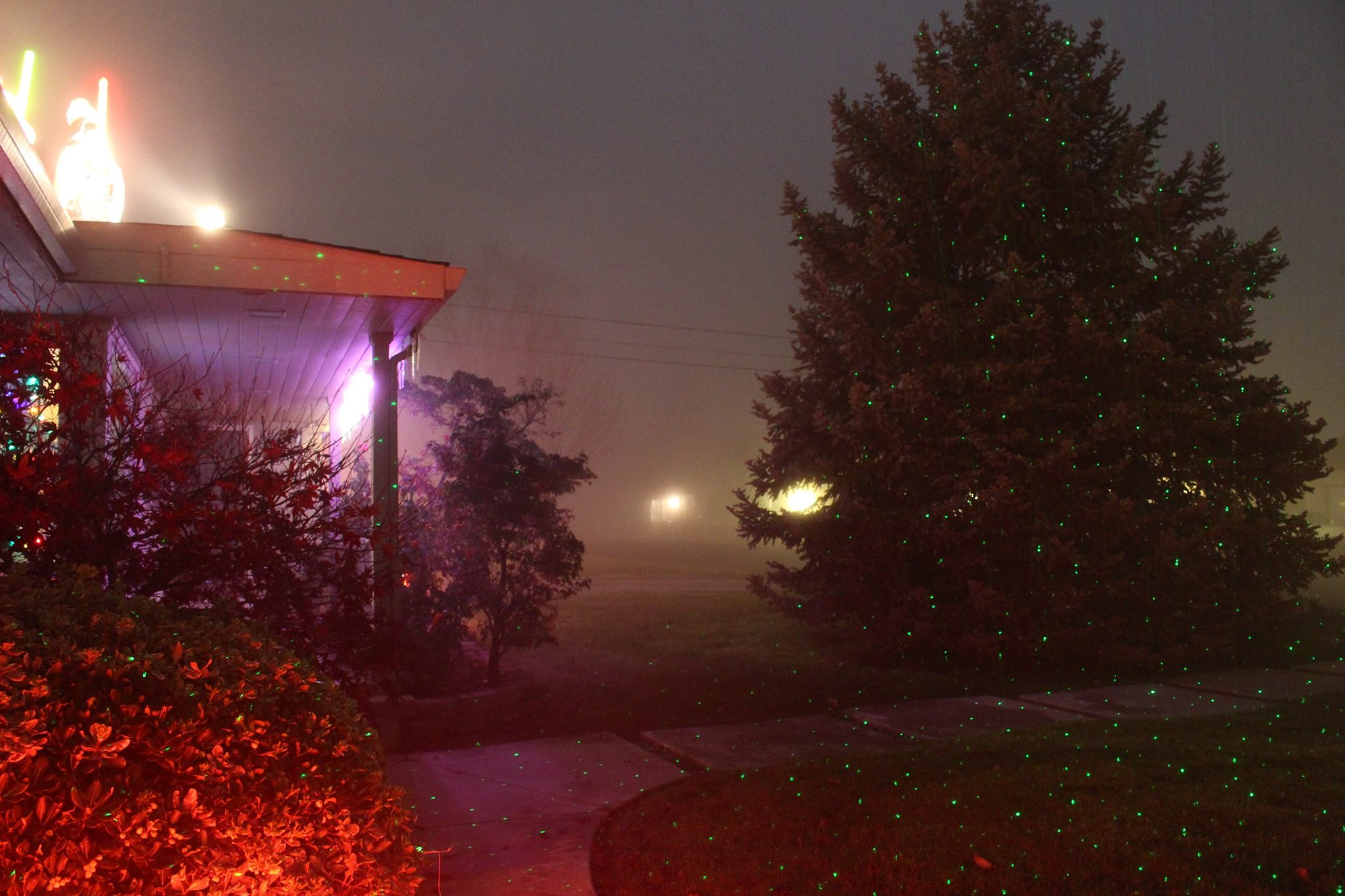 Christmas lighting effects from lasers and fog add to Sacramento